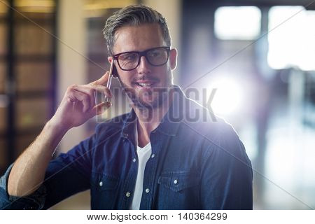 Man talking on cellphone in creative office