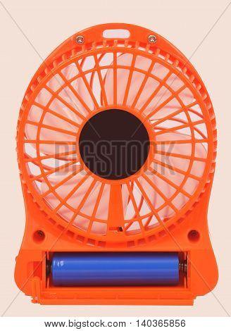 Orange mini fan Portable fan USB on white background