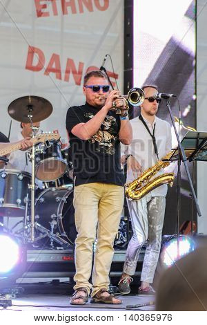 St. Petersburg, Russia - 2 July, Execution trumpet solo at the microphone, 2 July, 2016. Annual international festival of jazz and blues in St. Petersburg.