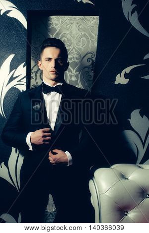 Handsome business man in a black suit