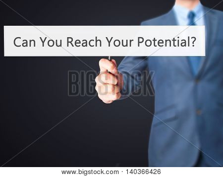 Can You Reach Your Potential ? - Business Man Showing Sign