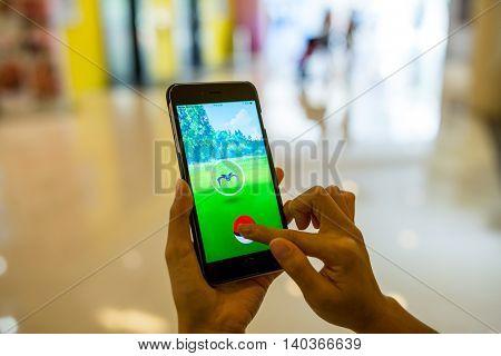 HONG KONG, CHINA, JULY 26, 2016 : Playing Pokemon Go on phone