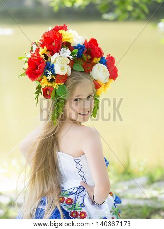 Small Girl In Embriodered Dress And Flower National Wreath