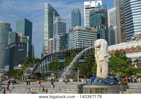 SINGAPORE - MAY 6 2016 : Tourists visit the Merlion Park a famous landmark of Singapore.