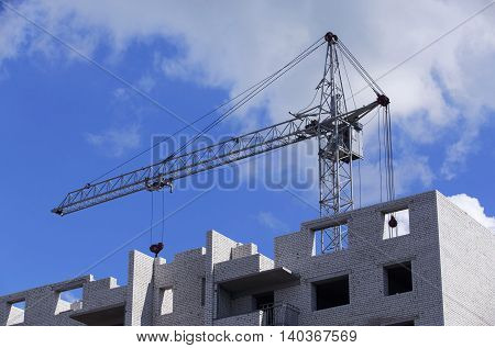 the construction crane on a background sky