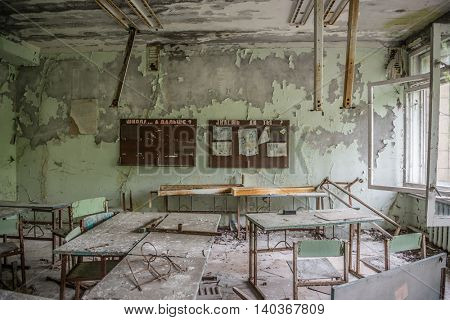 CHERNOBYL, UKRAINE-MAY,20: abandoned class room with furniture and debris on May 20, 2016 in Pripyat school