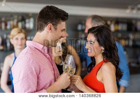 Couple toasting glass of champagne in restaurant
