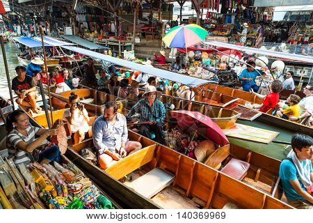 RATCHABURI THAILAND-MARCH 20: Damnoen Saduak Floating Market on March 20 2016 in Thailand. Having many small boats laden with Souvenir shop colourful fruits vegetables and Thai cuisine.