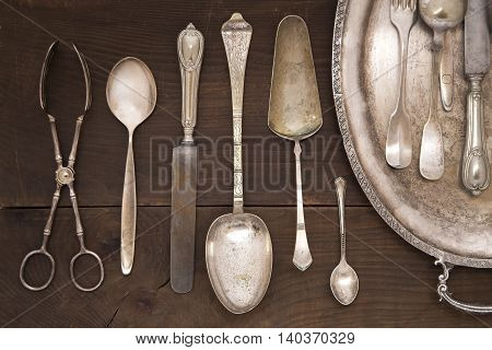 Vintage silver cutlery on a wooden background