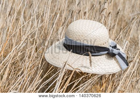 Straw hat on the golden wheat field