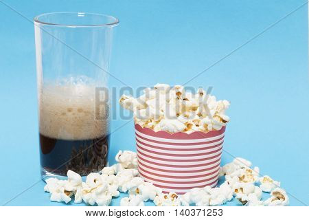 Popcorn and cola on a blue background