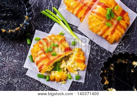 Baked vegetable cutlet with bacon on a dark background. Selective focus.