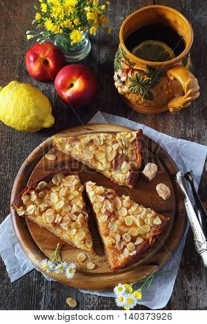 Apple pie fruits and tea with lemon in large ceramic mug