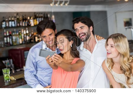 Group of friends taking a selfie in restaurant