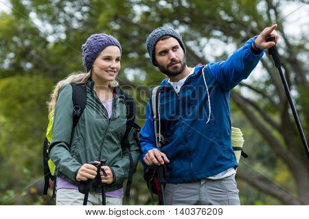 Hiker couple pointing at distance at countryside