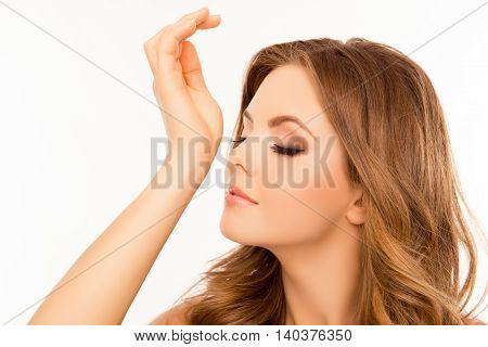 Beautiful Young Woman Smelling Aroma Of Parfume On Her Wrist