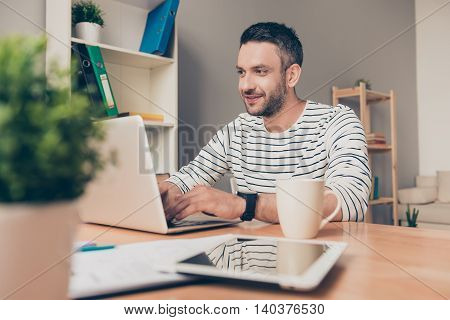 Handsome Man Sitting In His Office And Working On Laptop