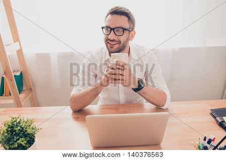 Portrait Of Smiling Businessman In Glasses Resting With Cup Of Coffee