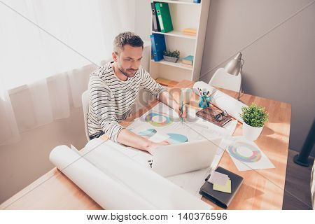 Concentrated Architect Working With Laptop To End His Project