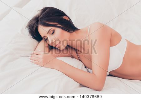Portrait Of Relaxed Calm Pretty Brunette Sleeping At Home
