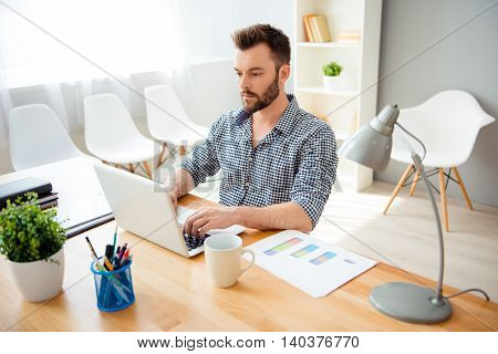 Handsome Bearded Concentrated Businessman Typing On Laptop
