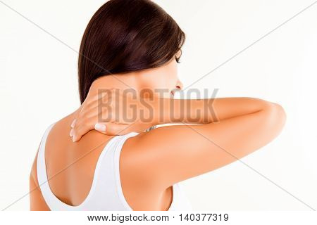 Close Up Of Woman With Pain In Her Neck Doing Massage