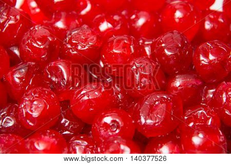 A Sticky glace cherries isolated on a white background
