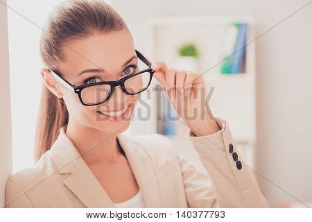 Portrait Of Beautiful Young Businesswoman Touching Her Glasses