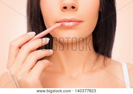Close Up Photo Of Young Woman Doing Maquillage With Lip's Liner