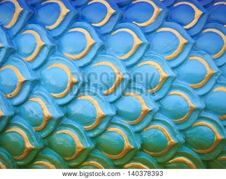 Sculpture of colorful serpent or dragon scales texture background