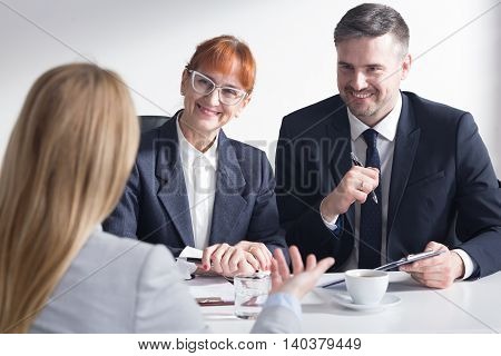 Recruiters are listening with satisfaction the presentation of female job applicant