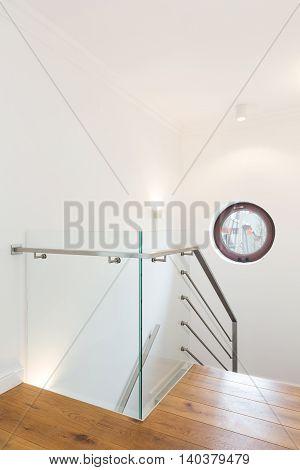 Minimalist Stairway Leading Down To Modern Interiors