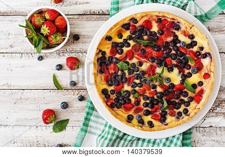 French Tart (flan) With Berries And Custard. Top View
