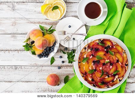 Delicate Biscuit Pie With Peaches And Blueberries. Top View