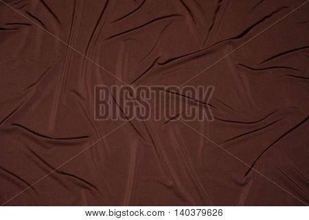 Elegant brown stockinet fabric texture of material for background.