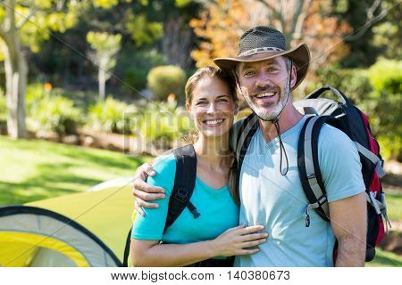 Portrait of hiker couple embracing each other in forest