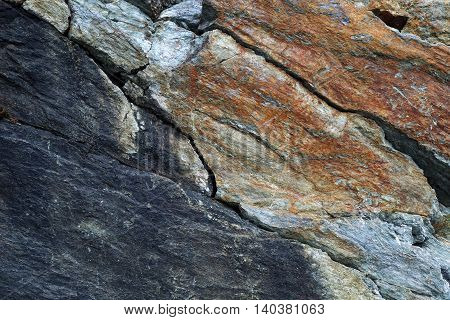 Background: stone picturesque relief,  multicolored rock texture