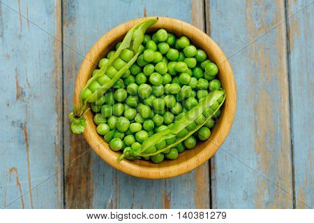Peas In Wooden Bowl On Wooden Background, Top View.