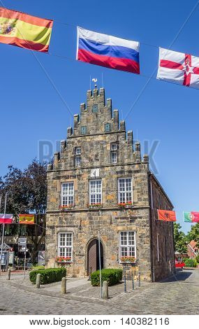 SCHUTTORF, GERMANY - JULY 19, 2016: Old city hall with flags in Schuttorf, Germany
