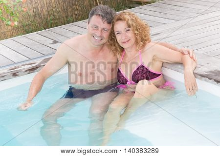 a Couple relaxing in the water. Summer.