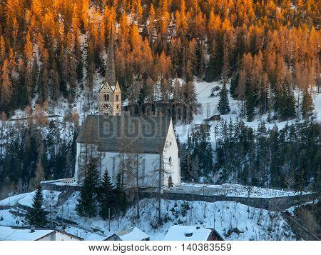 Small gothic church in Scuol village, Graubunden, Switzerland