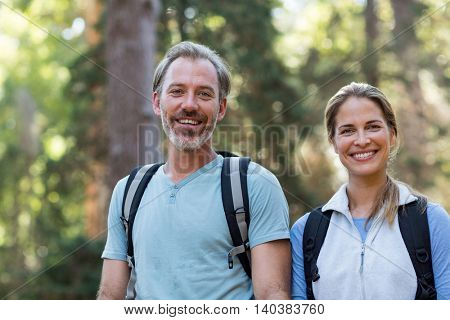Portrait of hiker couple hiking in forest at countryside