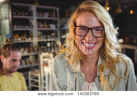 Portrait of happy young woman in cafeteria