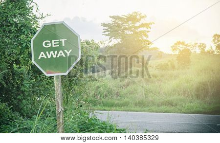 Country road signage tell you to get away