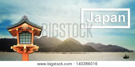 Destination Japan text on Japan island background with Buddhism lantern. Japanese Red Lantern with Miyajima island on the background. Japan travel Background banner.