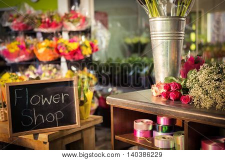 Slate with written text at flower shop