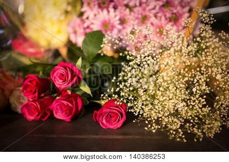 Close-up of red roses on table at flower shop
