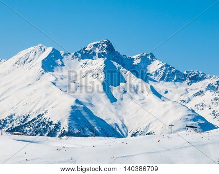 Sunny winter day in alpine ski resort with blue sky and bright white snow, Ischgl and Samnaun, Silvretta Arena, Austria - Switzerland