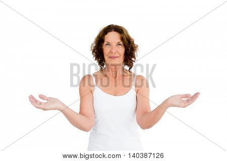 Portrait of confident mature woman against white background