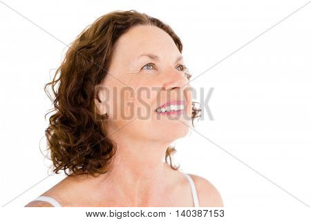 Close-up of happy mature woman against white background